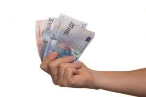 person holding euro bills